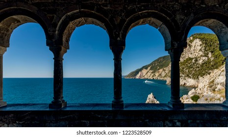 Stunning views of the sea through the external colonnade of the Church of San Pietro in Portovenere, Liguria, Italy