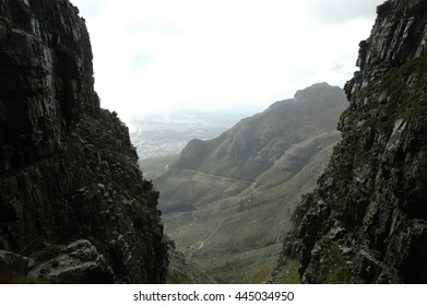 Stunning views of Table Mountain on a moody day, from the way up the Platteklip Gorge to the summit plateau and along the coast to the Twelve Apostles, Cape Town, South Africa.