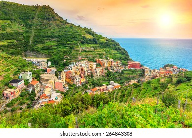 Stunning vineyard valley,magical sunset and beautiful riviera of Cinque Terre,Manarola town,Italy,Europe