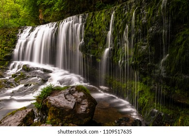The stunning waterfall of Sgwd Isaf Clun-gwyn (lower fall of the white meadow) along the four waterfall walk, waterfall country, Brecon Beacons, Wales