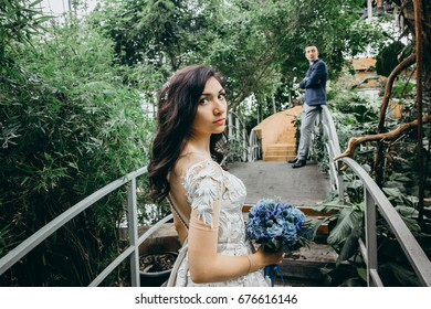 Stunning  wedding couple in the tropic garden