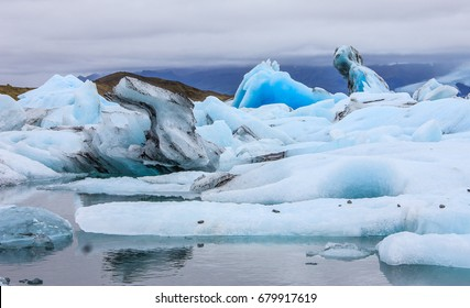 Stunning winter day view of Jokulsarlon, glacial river lagoon, large glacial lake, southeast Iceland, on the edge of Vatnajokull National Park, one of the natural wonders of Iceland.