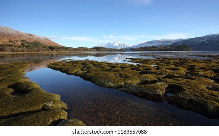 Stunning winter landscape with Ben Nevis with her winter coat on taken from Inverscaddle Bay at Conaglen on the shores of Loch Linnhe in Lochaber.