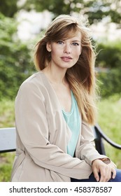 Stunning woman on bench, portrait