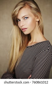 Stunning young blond woman in striped top, portrait