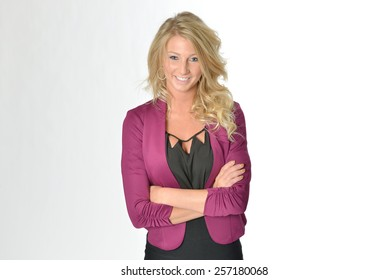 Stunning young blonde woman in business attire - fuscia jacket and black blouse