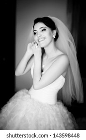 stunning,  young brunette bride, black and white picture
