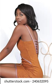 Stunning young lady sitting in a chair and wearing brown dress