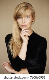 Stunning young woman in black dress, portrait