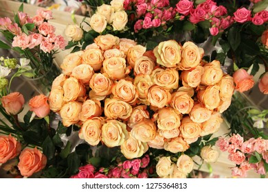 Stunningly beautiful peach roses in a huge bouquet among other flowers