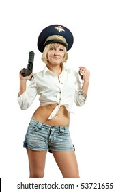 A stunningly beautiful young woman posing with a handgun