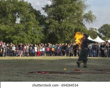 The stuntman, embroiled in a flame in a medieval costume, runs against the spectators and participants of the show. During the reconstruction of the medieval battle. Dnipro, Ukraine. 20th May 2017.