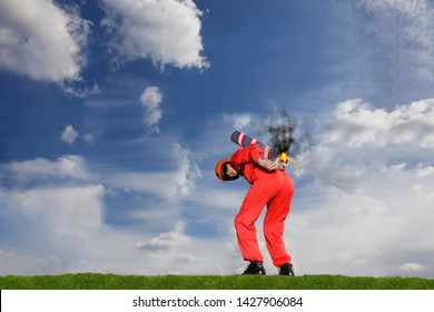 Stuntman igniting a rocket strapped to his back