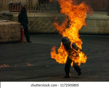 stuntman running on fire