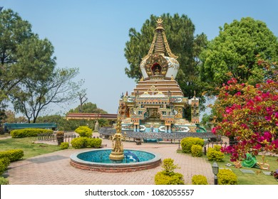 Stupa and the fountain in the Park of the Buddhist Kopan monastery, Kathmandu, Nepal.
