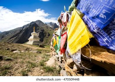 Stupa and prayer flag on the way to Kargil, Jammu and Kashmir state, India.