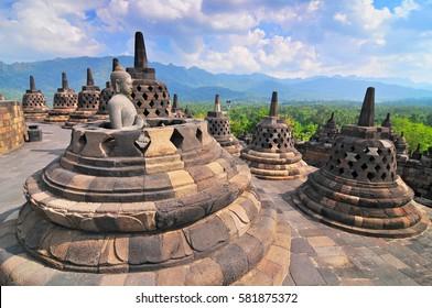 Stupas and Statue of Buddha at Borobudur Temple, Yogjakarta Indonesia.