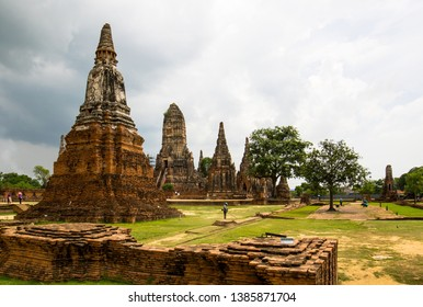 Stupas and trees in Ayutthaya Thailandia on cloudy day