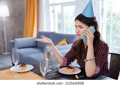 Stupid excuses. Birthday woman wearing fancy clothes feeling very angry hearing stupid excuses from boyfriend