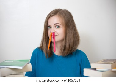 Stupid looking girl with pens in her nostrils