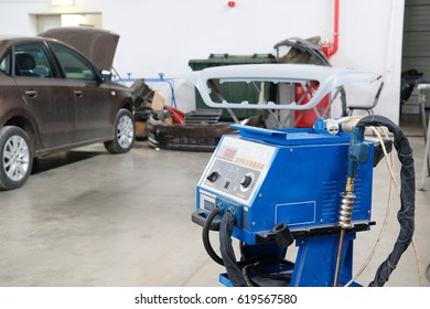 Stupino, Moscow region, Russia - April, 4, 2017: Car repair station with welder in a frontground