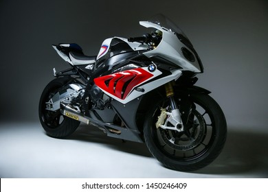 Stupino/Russia - JANUARY 27, 2017 sportbike bmw s1000rr on smooth background with shapes front side view. modern powerful motorcycle on dark grey background.
