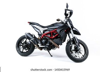 Stupino/Russia - MARCH 25, 2016 Black Ducati Hypermotard on a white background side view. black motorcycle with a red frame isolated on white background. urban high sport motorbike