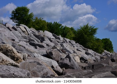 The sturdy erosion control boulders along the shores of Lake Michigan to protect the bluff.