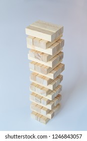 A sturdy tower of wooden blocks on a light gray background.