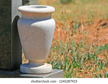 STURDY WHITE VASE ON A GRAVESTONE