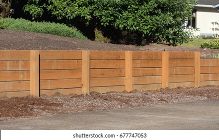 Sturdy wooden retaining wall in a neighborhood for erosion protection