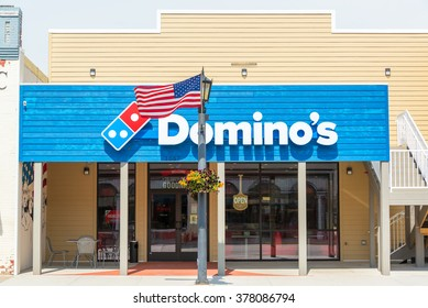 STURGIS, SD - AUGUST 26: Dominos Pizza and American flag in Sturgis, SD on August 26, 2015