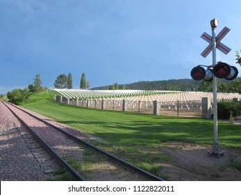 Sturgis South Dakota 2014. View of train tracks moving pass a cemetery. South Dakota Black Hills July 2014.