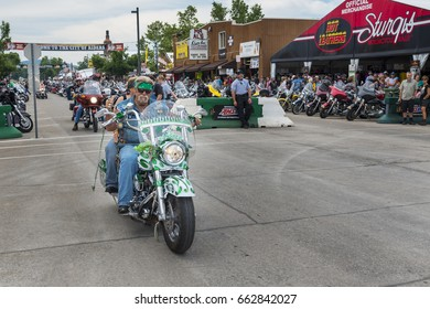 Sturgis, South Dakota - August 8, 2014: Rider in the main street of the city of Sturgis, in South Dakota, USA, during the annual Sturgis Motorcycle Rally