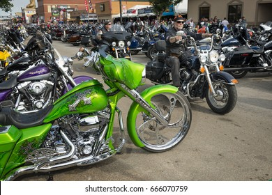 Sturgis, South Dakota - August 8, 2014: Riders in the main street of the city of Sturgis, in South Dakota, USA, during the annual Sturgis Motorcycle Rally