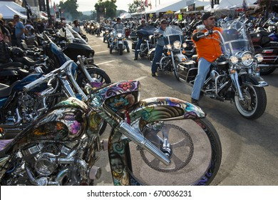 Sturgis, South Dakota - August 9, 2014: Riders in the main street of the city of Sturgis, in South Dakota, USA, during the annual Sturgis Motorcycle Rally