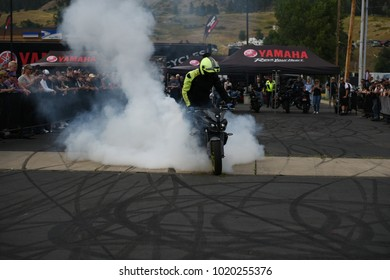 Sturgis, South Dakota / USA - August 5 2017: Smoke clouds rising as a motorcycle rider does a burnout at the Sturgis Motorcycle Rally.