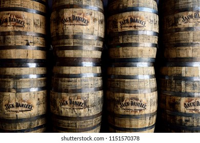 Sturgis, South Dakota / USA - August 4 2018: Rows of stacked banded wooden Jack Daniels aged oak whiskey barrels.