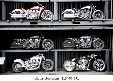 Sturgis, South Dakota / USA - August 5 2018: Group of several Indian motorcycles on display in compartments at the Sturgis motorcycle rally in South Dakota.