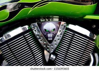 Sturgis, South Dakota / USA - August 4 2018: Close up of a chrome Victory Motorcycle engine assembly and fuel tank.