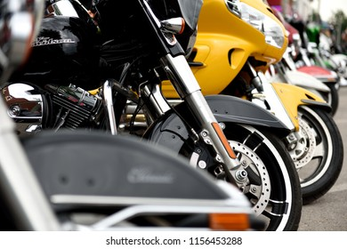 Sturgis, South Dakota / USA - August 5 2018: Row of motorcycles parked on the street during the annual Sturgis motorcycle rally.