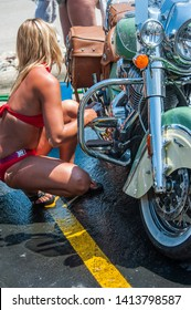 Sturgis, South Dakota, USA - August 5, 2015 Girls cleaning bikes in Sturgis for the annual rally