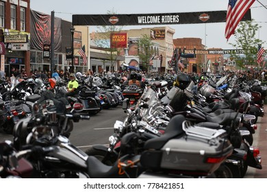 Sturgis, South Dakota / USA - August 05 2017: View of Main Street, hundreds of motorcycles line the streets under a Welcome Riders banner during the annual worlds largest motorcycle rally event.