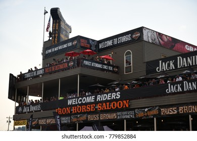 Sturgis, South Dakota / USA - August 05 2017: Crowds of motorcycle enthusiasts gather on balconies during the worlds largest motorcycle rally in Sturgis.