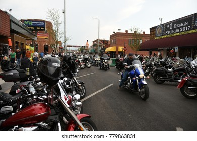 Sturgis, South Dakota / USA - August 05 2017: Motorcycle riders and motorcycles on Main Street in Sturgis during the worlds largest motorcycle rally.