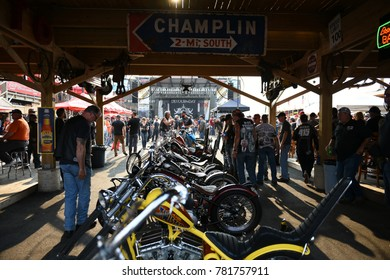 Sturgis, South Dakota / USA - August 05 2017: Crowds of motorcycle enthusiasts and a row of chopper motorcycles during the worlds largest motorcycle rally in Sturgis.