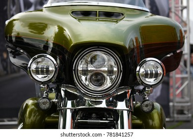 Sturgis, South Dakota / USA - August 05 2017 - Harley Davidson motorcycle front end view, green color, chrome and headlights.