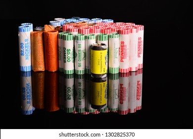 Sturtevant, Wisconsin / USA - January 3 2019: Rolls of US coins stacked on end copy space around the coinage.