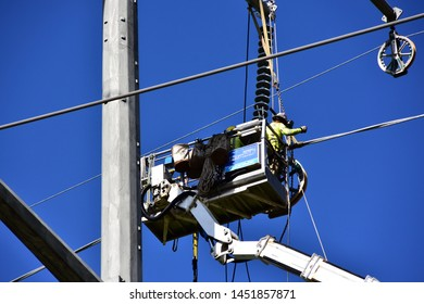 Sturtevant, Wisconsin / USA - July 15, 2019: Workers remove a large pully while  installing power lines to supply electrical power to the Mount Pleasant Foxconn project in Racine County.