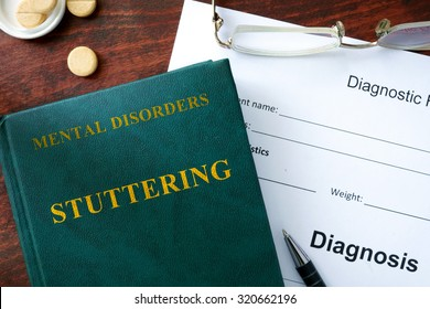 Stuttering  concept. Diagnostic form and book on a table.